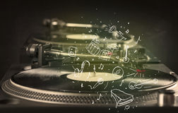 Turntable playing classical music with icon drawn instruments. Concept on background Stock Image
