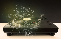 Turntable playing classical music with icon drawn instruments Stock Photo