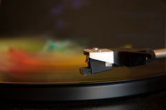 Turntable playing colorful music Stock Photography