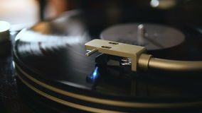 Turntable playing music with hand with backlight close up. Oldschool hipster concept. Turntable playing music with hand stock footage