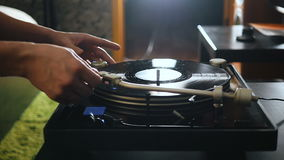 Turntable playing music with hand with backlight. Oldschool hipster concept. Turntable playing music with hand stock footage