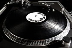 Turntable playing vinyl audio record stock photo
