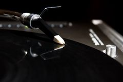 Turntable playing vinyl audio record. Professional analog djing equipment playing the music Stock Image