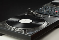 Turntable playing vinyl close up with needle on the record Royalty Free Stock Photography