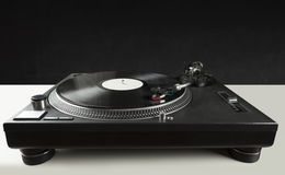 Turntable playing vinyl close up with needle on the record Stock Photos