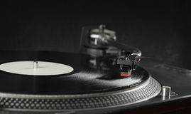 Turntable playing vinyl close up with needle on the record Royalty Free Stock Photo