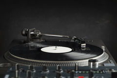 Turntable playing vinyl close up with needle on the record Stock Image