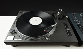 Turntable playing vinyl close up with needle on the record Stock Photography