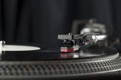 Turntable playing vinyl close up with needle on the record Stock Images