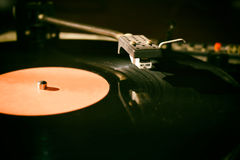 Turntable. Playing vinyl close up with needle on the record with grey background Royalty Free Stock Photography