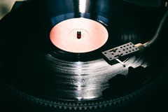 Turntable. Playing vinyl close up with needle on the record with grey background Stock Photos