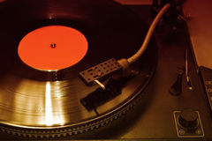Turntable. Playing vinyl close up with needle on the record with grey background Stock Images