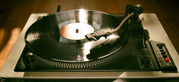 Turntable. Playing vinyl close up with needle on the record with grey background Stock Photo