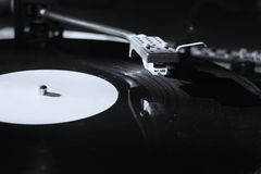 Turntable. Playing vinyl close up with needle on the record with grey background Royalty Free Stock Images