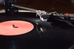 Turntable. Playing vinyl close up with needle on the record with grey background Royalty Free Stock Photos