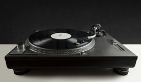 Turntable playing vinyl close up with needle on the record Royalty Free Stock Image