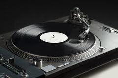 Turntable playing vinyl close up with needle on the record Royalty Free Stock Images