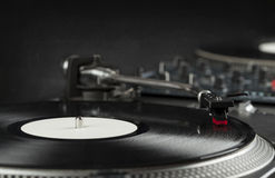 Turntable playing vinyl close up with needle on the record Royalty Free Stock Photos