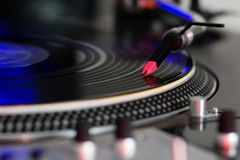 Turntable playing vinyl disc Royalty Free Stock Image