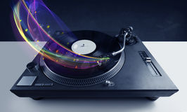 Turntable playing vinyl with glowing abstract lines Stock Image