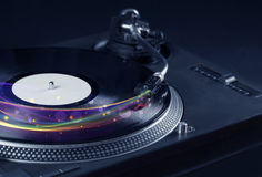 Turntable playing vinyl with glowing abstract lines Stock Photo