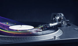 Turntable playing vinyl with glowing abstract lines Royalty Free Stock Photo