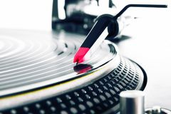 Turntable playing vinyl with music. Professional audio equipment - spherical needle on a vinyl record Stock Photos