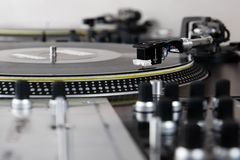 Turntable playing vinyl music record Stock Photo