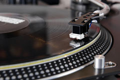 Turntable playing vinyl music record Royalty Free Stock Photo