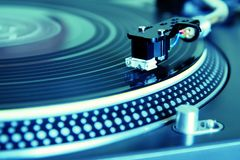 Turntable playing vinyl record Stock Photography
