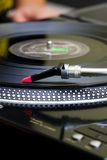 Turntable playing vinyl record. Professional scratch needle on the vinyl surface Royalty Free Stock Photography