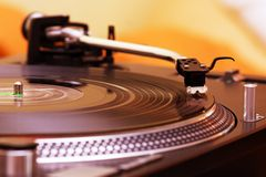 Turntable playing vinyl record. Record player spinning the disc with music Stock Image