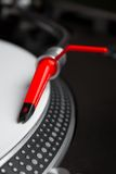 Turntable playing vinyl record. Professional DJ audio equipment - shperical turntable needle on white vinyl record Royalty Free Stock Photography