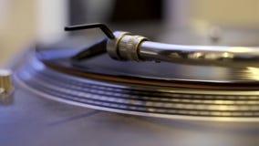 Turntable playing vinyl record. Macro stock video footage
