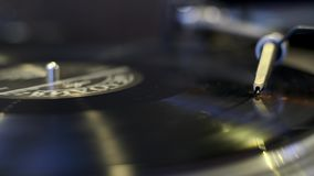 Turntable playing vinyl record. Macro stock video
