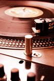Turntable playing vinyl record with music. Close shot of analog audio equipment, useful for a professional DJ Stock Photo