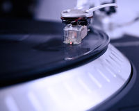 Turntable playing vinyl record with music Stock Photo