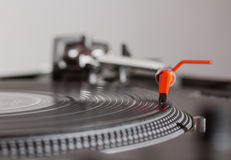 Turntable playing vinyl record with music. Close up, macro photo. Professional audio equipment for DJ, nightclub or audio enthusiast Stock Images