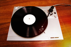 Turntable playing vinyl record with music Stock Images