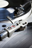 Turntable playing vinyl record with music Royalty Free Stock Images