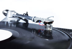 Turntable playing vinyl record with music. Professional sound equipment for a disc jockey. Turntable vinyl record players and 2 channel sound mixing controller Royalty Free Stock Photography