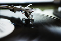 Turntable playing vinyl record with music Royalty Free Stock Image