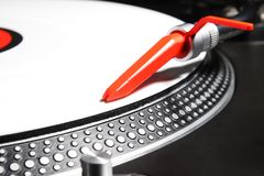 Turntable playing viyl record with music Royalty Free Stock Image
