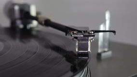The turntable plays the disc. Turntable. The needle falls on a vinyl disc stock video footage