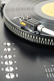 Turntable plays vinyl record Stock Photo