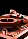 Turntable on red. Dj's vinyl player isolated on black background Stock Photos