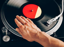 Turntable scratch, hand of dj on the vinyl record Stock Image