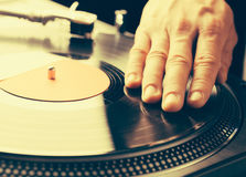 Turntable scratch, hand of dj on the vinyl record Stock Photo