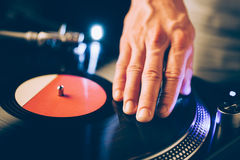 Turntable scratch, hand of dj on the vinyl record Royalty Free Stock Photo