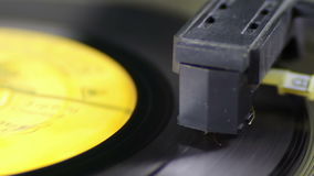 Turntable With Spinning Vinyl. Macro shot of old vinyl recording rotating in vintage player. Good for record player, gramophone, party, DJ, music, and more stock video footage
